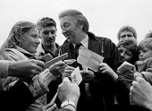 Arthur Scargill signing autographs, 15,000 Miners protest, Mansfield, Nottinghamshire - John Harris - ,Arthur,Scargill,autograph,autographs,boy,boys,child,children,family,girl,girls,Miner's Strike,the,Miners Strike,Miners Strike,Miner's Strike,NUM,num,protest,demonstration,strike,strikes,supporter,sup