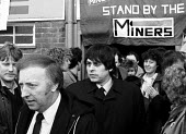 Arthur Scargill NUM folowed by Jim Parker, Scargills chauffeur, WAPC rally Chesterfield at the end of the Miners strike, International Womens Day - John Harris - 09-03-1985