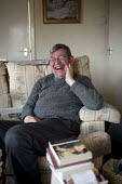 John, a disabled schizophrenic who hears voices, at home with his books which he reads avidly. His benefits have been reduced by the bedroom tax as his flat has a spare room. Stratford upon Avon, Warw... - John Harris - 2010s,2014,adult,Adult Education,adults,alone,bedroom,BEDROOMS,benefit,benefits,BOOK,books,disabilities,disability,disability living allowance,disable,disabled,disablement,dla,edu,educate,educating,ed
