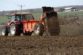 Muck spreading on a farm, Warwickshire - John Harris - 2010s,2014,agricultural,agriculture,Ammonia gas,capitalism,capitalist,contractor,contractors,driver,drivers,driving,EBF,Economic,Economy,emissions,employee,employees,Employment,eni,environment,Environ