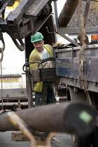 Contractors replacing a telegraph pole for BT. - John Harris - 01-04-2014