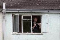 A Glazier fitting double glazing to a window. - John Harris - 29-04-2014