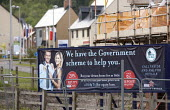 We have a government scheme to help you, help to buy mortgage equity loan sign on a building site with new houses, Telford. - John Harris - 19-05-2014