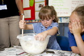 Making a cake mixture in a mixing bowl, cookery, St Richard's C E First School, Evesham - John Harris - 2010s,2014,child,CHILDHOOD,children,class,classroom,classrooms,edu,educate,educating,education,educational,female,females,food,food preparation,FOODS,from,girl,girls,juvenile,juveniles,kid,kids,knowle