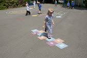 Hopscotch in the playground, St Richard's C E First School, Evesham - John Harris - 2010s,2014,child,CHILDHOOD,children,edu,educate,educating,education,educational,female,females,girl,girls,Hopscotch,juvenile,juveniles,kid,kids,knowledge,learn,learner,learners,learning,outdoors,outsi