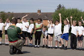 Commando Joe; wake and shake and initiative to improve attendance and punctuality by working with an ex member of the armed forces, lining up in the playing field, St Richard's C E First School, Evesh... - John Harris - 02-07-2014