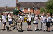 Commando Joe, a crocodile comes down the line; wake and shake and initiative to improve attendance and punctuality by working with an ex member of the armed forces, lining up in the playing field, St... - John Harris - 02-07-2014