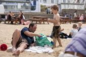 Farther and son, St Richards C E First School trip to the seaside, Weston Super Mare, Somerset - John Harris - 04-07-2014