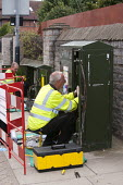Engineers installing Fibre Optic Broadband, BT Openreach PCP street cabinet, Warwickshire - John Harris - 2010s,2014,box,boxes,British Telecom,Broadband,BT,cable,CABLES,cabling,communicating,communication,EBF,Economic,Economy,employee,employees,Employment,engineer,engineers,fibre optic broadband,Fibre Opt