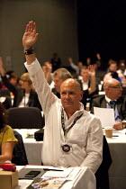 FBU delegate voting, TUC, Liverpool 2014 - John Harris - 2010s,2014,conference,conferences,delegate,DELEGATES,democracy,FBU,Hands up,Liverpool,member,member members,members,people,trade union,trade union,trade unions,trades union,trades union,trades unions,