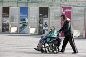 A carer pushing his elderly disabled mother, Liverpool 2014 - John Harris - 10-09-2014