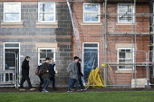 Students walking to college past new housing nearing completion which they may never be able to afford, Stratford-upon-Avon, Warwickshire - John Harris - 18-12-2014
