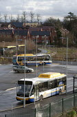 A bus at a stop, park and ride scheme and new housing, Bishopton, Stratford-upon-Avon, Warwickshire - John Harris - 2010s,2014,bus,bus service,Bus Stop,buses,EBF,Economic,Economy,highway,housing,infrastructure,Local,park AND ride,RAIL,railway,RAILWAYS,road,roads,service,services,Sustainable,town,towns,Transport,tra