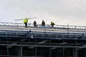 Construction workers on the roof of a new development, Wellesbourne Distribution Park, Warwickshire - John Harris - 18-12-2014