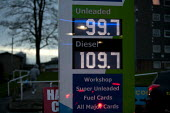 Price per litre of petrol on a garage forecourt goes down to below 1 for the fist time as the price of oil drops. Druids Heath, Birmingham - John Harris - 14-01-2015