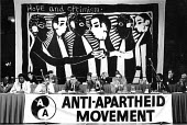 AAM AGM, Sheffield, 1988. Woodcut by Namibian artist John Muafangejo used as the platform backdrop - John Harris - 1980s,1988,AAM,activist,activists,against,AGM,Annual General Meeting,Anti Apartheid Movement,Anti-Apartheid,artist,ARTISTS,banner,banners,bigotry,CAMPAIGNING,CAMPAIGNS,DEMONSTRATION,DISCRIMINATION,INE