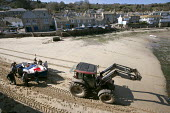Tractor and fishermen launching the fishing fleet at the start of the season, Mousehole harbour, Cornwall - John Harris - 2010s,2015,assisting,beach,BEACHES,boat,boats,coast,coastal,coasts,cottage,cottages,crew,crewman,crewmen,crewmenmaritime,dock,docks,dockside,EARNINGS,EBF,Economic,Economy,employee,employees,Employment