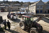 Tractor and fishermen launching the fishing fleet at the start of the season, Mousehole harbour, Cornwall - John Harris - 2010s,2015,assisting,beach,BEACHES,boat,boats,coast,coastal,coasts,crew,crewman,crewmen,crewmenmaritime,dock,docks,dockside,EARNINGS,EBF,Economic,Economy,employee,employees,Employment,EQUALITY,fisheri