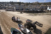 Tractor and fishermen launching the fishing fleet at the start of the season, Mousehole harbour, Cornwall - John Harris - 21-03-2015