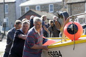 Launching the fishing fleet at the start of the season, Mousehole harbour, Cornwall - John Harris - 21-03-2015