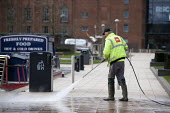 A Biffa street cleaner using a water jet to remove chewing gum from the pavement. Stratford upon Avon, Warwickshire - John Harris - 01-04-2015