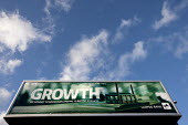 Growth, a Lloyds bank advertisement advertising lending to British business, with a model of a factory, Birmingham - John Harris - 2010s,2015,advert,ADVERTISED,advertisement,advertisements,advertising,ADVERTISMENT,adverts,bank,banking,banks,billboard,billboards,Birmingham,borrower,borrowers,borrowing,business,capital,capitalism,c