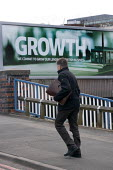 Growth, a Lloyds bank advertisement advertising lending to British business, with a model of a factory, Birmingham - John Harris - 2010s,2015,advert,ADVERTISED,advertisement,advertisements,advertising,ADVERTISMENT,adverts,bank,banking,banks,billboard,billboards,Birmingham,borrower,borrowers,borrowing,briefcase,business,businessma