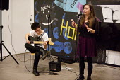 Anna Turner and Emilio Villano Harris performing at Nexus, a cross-art form, collaborative showcase series by Beatfreeks and Creative Superheroes, Ikon Gallery, Brindley Place, Birmingham - John Harris - 2010s,2015,ACE,adolescence,adolescent,adolescents,arts,Birmingham,boy,boys,Brindley Place,Brindleyplace,child,CHILDHOOD,children,culture,FEMALE,Gallery,guitar,guitars,improv,improvisation,instruments,