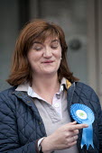 Nicky Morgan MP canvassing in the streets of Loughborough, Leicestershire - John Harris - ,2010s,2015,campaign,campaigning,CAMPAIGNS,CANVASING,canvassing,CONSERVATIVE,Conservative Party,conservatives,DEMOCRACY,election,elections,FEMALE,funny,General Election,Humor,HUMOROUS,HUMOUR,joking,la