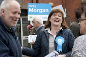 Nicky Morgan MP canvassing in the streets of Loughborough, Leicestershire - John Harris - 2010s,2015,campaign,campaigning,CAMPAIGNS,CANVASING,canvassing,communicating,communication,CONSERVATIVE,Conservative Party,conservatives,conversation,conversations,DEMOCRACY,dialogue,discourse,discuss