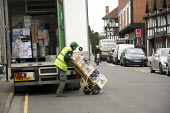 Driver unloading a delivery, Stratford upon Avon, Wawickshire - John Harris - 2010s,2015,bottle,bottles,deliver,deliveries,DELIVERING,delivery,driver,drivers,driving,EARNINGS,EBF,Economic,Economy,employee,employees,Employment,EQUALITY,HAULAGE,HAULIER,HAULIERS,hazard,hazardous,h