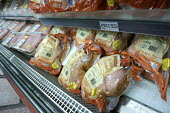 Chickens for sale in Morrisons Supermarket. Nearly three-quarters of fresh shop-bought chickens have tested positive for food poisoning bug Campylobacter in a Food Standards Agency survey. - John Harris - ,2010s,2015,Agency,bacteria,bird,birds,bought,buy,buyer,buyers,buying,Campylobacter,chicken,chickens,commodities,commodity,consumer,consumers,contaminated,contamination,customer,customers,EBF,Economic