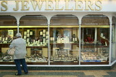 Woman looking into a Jewellers shop window, Stratford Upon Avon. - John Harris - 2010s,2015,bought,buy,buyer,buyers,buying,Carat of Gold,commodities,commodity,consumer,consumers,customer,customers,goods,jeweler,jewelers,Jeweller,Jewellers,jewellery,jewellery jewelry,jewelry,jewels