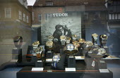 Luxury Tudor men's watches in the window of a prestige jewellers, Stratford Upon Avon, Warwickshire - John Harris - 2010s,2015,activities,activity,AFFLUENCE,AFFLUENT,bought,Bourgeoisie,buy,buyer,buyers,buying,commodities,commodity,consumer,consumers,customer,customers,early,EBF Economy,elite,elitism,EQUALITY,George