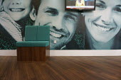 Dentist waiting Room 3, with photograph of happy smiling family with white teeth, Stratford upon Avon, Warwickshire - John Harris - 2010s,2015,chair,chairs,dental,dentist,dentistry,dentists,EMOTION,EMOTIONAL,EMOTIONS,families,family,HAPPINESS,happy,hea,health,mural,murals,people,photograph,practitioner,practitioners,seating,SMILE,