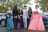 Pupils arriving at their High school Prom, at the end of the last year at school, Henley in Arden, Warwickshire - John Harris - 2010s,2015,ACE,adolescence,adolescent,adolescents,ARRIVAL,arrivals,arrive,arrived,arrives,arriving,boy,boys,child,CHILDHOOD,children,culture,Dress,dressed up,dresses,edu,educate,educating,education,ed