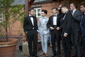 Pupils arriving at their High school Prom, at the end of the last year at school, Henley in Arden, Warwickshire - John Harris - 2010s,2015,ACE,adolescence,adolescent,adolescents,ARRIVAL,arrivals,arrive,arrived,arrives,arriving,boy,boys,child,CHILDHOOD,children,communicating,communication,conversation,conversations,culture,dial
