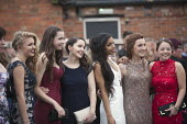 Pupils arriving at their High school Prom, at the end of the last year at school, Henley in Arden, Warwickshire - John Harris - 2010s,2015,ACE,adolescence,adolescent,adolescents,ARRIVAL,arrivals,arrive,arrived,arrives,arriving,child,CHILDHOOD,children,culture,Dress,dressed up,dresses,edu,educate,educating,education,educational