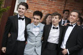 Pupils arriving at their High school Prom, at the end of the last year at school, Henley in Arden, Warwickshire - John Harris - 2010s,2015,ACE,adolescence,adolescent,adolescents,ARRIVAL,arrivals,arrive,arrived,arrives,arriving,child,CHILDHOOD,children,culture,dressed up,edu,educate,educating,education,educational,Emilio,End Of