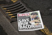 Front page of The Sun with a photograph showing Ed Miliband eating a bacon sandwich with the headline Save our Bacon, don't swallow his porkies and keep him out- suggesting the electorate should not v... - John Harris - 07-05-2015