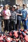 Putting on life jeckets. Pupils Bellboating on the river Avon, St Richard's First School, Evesham - John Harris - 11-06-2015