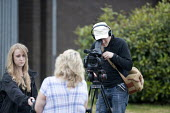 Journalist and camera oparator from CWU TV reporting on the Keep Wednesbury Working protest. CWU activists and members protest outside Dixons Carphone distribution centre, Wednesbury against 500 job l... - John Harris - 12-06-2015