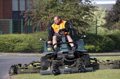 Subcontractor mowing the grass verge on a ride-on lawnmower, Evesham - John Harris - 11-06-2015