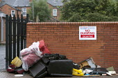 Rubbish dumped on the street by a City council NO DUMPING sign Birmingham - John Harris - 26-07-2015