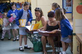 Parents going through exercise books. Open Day for parents of pupils at primary school, St Richards First School, Evesham, Worcestershire - John Harris - 06-07-2015