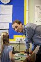 Primary school, St Richards First School, Evesham, Worcestershire - John Harris - 2010s,2015,child,CHILDHOOD,children,class,communicating,communication,conversation,conversations,dialogue,discourse,discuss,discusses,discussing,discussion,employee,employees,Employment,female,females