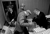 Pensioners and the unemployed queueing to receive milk and butter from the Salvation Army distributing part of the E.E.C. intervention store surplus of 1.4 million ton of unsold subsidised butter crea... - John Harris - &,1980s,1987,adult,adults,age,ageing population,aid,assistance,belief,Birmingham,butter,CAP,charitable,charity,christian,christianity,cities,city,communities,Community,conviction,distributing,distribu