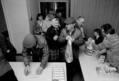 Pensioners and the unemployed queueing to receive milk and butter from the Salvation Army distributing part of the E.E.C. intervention store surplus of 1.4 million ton of unsold subsidised butter crea... - John Harris - 12-03-1987