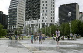 Children playing in the fountain, Eastside, Birmingham - John Harris - 2010s,2015,ACE,architecture,Birmingham,blocks,boy,boys,building,buildings,child,CHILDHOOD,children,cities,City,City centre,cityscape,cityscapes,Culture,female,females,girl,girls,heat,High Rise,hot,juv