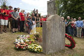 Wreath laying at the grave of James Hammett, Tolpuddle Martyrs' Festival. Dorset - John Harris - 2010s,2015,cemeteries,cemetery,CHURCH,churches,churchyard,churchyards,emotion,emotional,emotions,FEMALE,floral,flower,flowering,flowers,grave,graves,gravestone,gravestones,graveyard,graveyards,grief,g